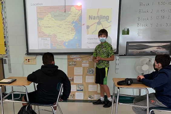 Middle school student Charlie Truitt did an amazing presentation to Gowana Team 6-2 about his experiences while living in China.